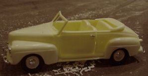 Plastic model of a 1948 Ford convertible.